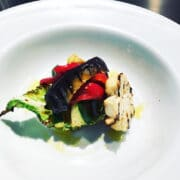 Grilled courgette, aubergine and cauliflower with roasted red pepper anointed with truffle oil