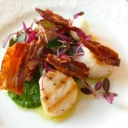Grilled scallops with a basil and pea pesto, pancetta shards, quail egg, amarath micro herb