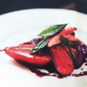Saddle of venison with roasted pear and red cabbage compote and sage leaves